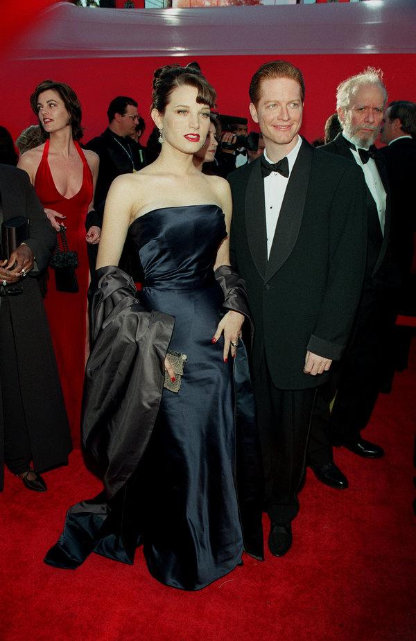 (Original Caption) Bridget Fonda and Eric Stoltz arrive at the Shrine auditorium. (Photo by Frank Trapper/Corbis...