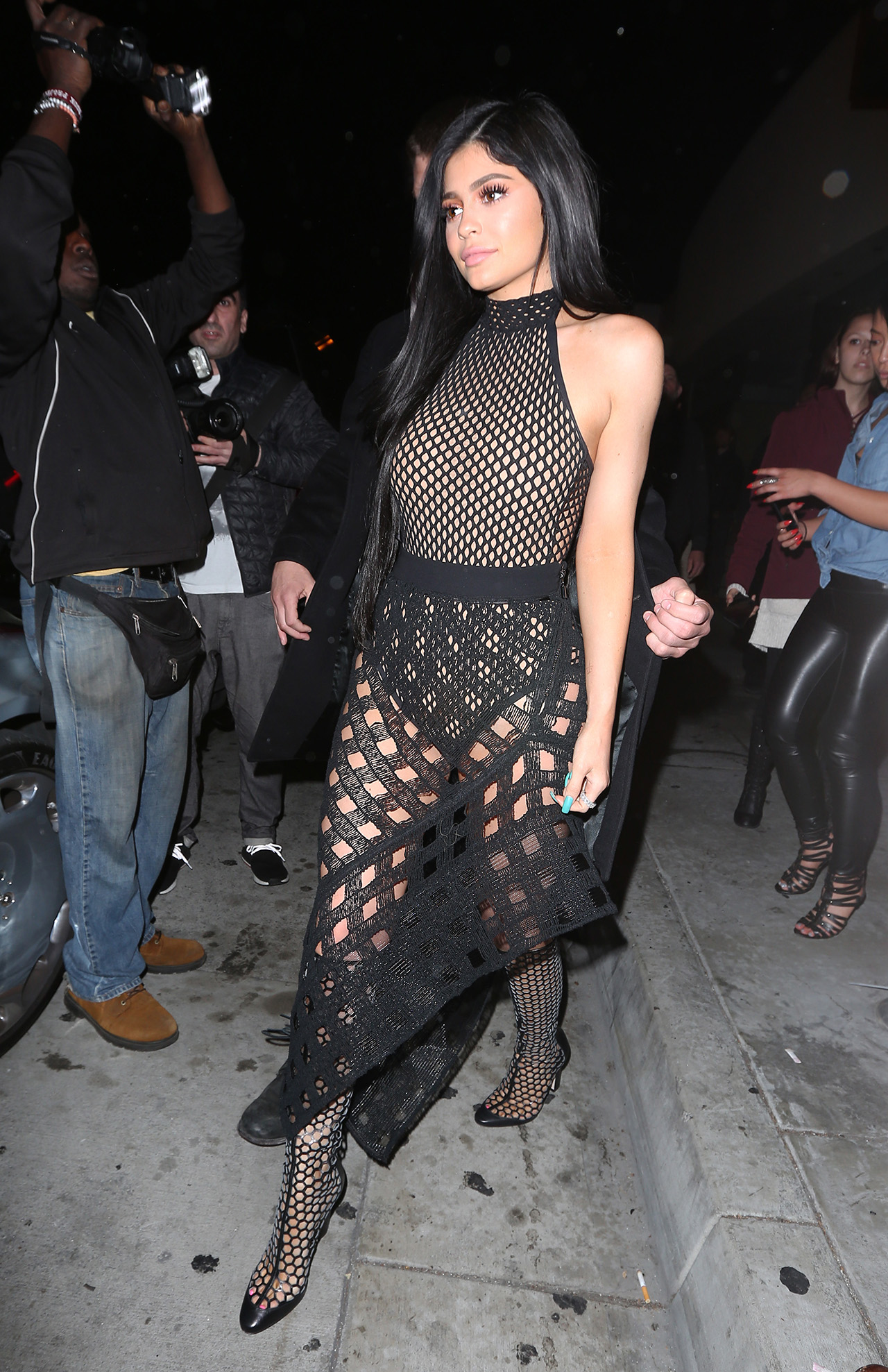 Kylie Jenner displays her curves in a sheer black dress as she leaves Catch restaurant in West Hollywood. <P> Pictured: Kylie Jenner <B>Ref: SPL1460406  110317  </B><BR/> Picture by: Photographer Group / Splash News<BR/> </P><P> <B>Splash News and Pictures</B><BR/> Los Angeles:310-821-2666<BR/> New York:212-619-2666<BR/> London:870-934-2666<BR/> photodesk@splashnews.com<BR/> </P>