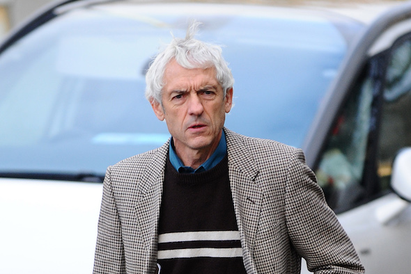 """A speeding driver who deployed a James Bond-style smokescreen device in a bid to shake off police has been spared jail.  Simon Chaplin, 62, rigged a bucket of diesel, a pump and pipes, behind the passenger seat of his Peugeot 309 to produce """"colossal"""" amounts of grey smoke from his exhaust.  A court heard """"eccentric"""" Chaplin activated the device when a policeman attempted to pull him over for speeding and covered the carriageway with fumes.  Chaplin tried to evade the officer's flashing blue lights but the policeman was simply able to follow the billowing plumes through country roads near Haverfordwest, Pembs.   Pictured here is Simon Chaplin at Swansea crown court.  © WALES NEWS SERVICE"""