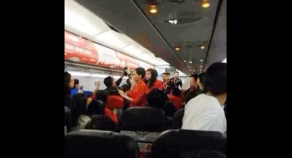 Plane passengers scald flight attendant with hot water and noodles