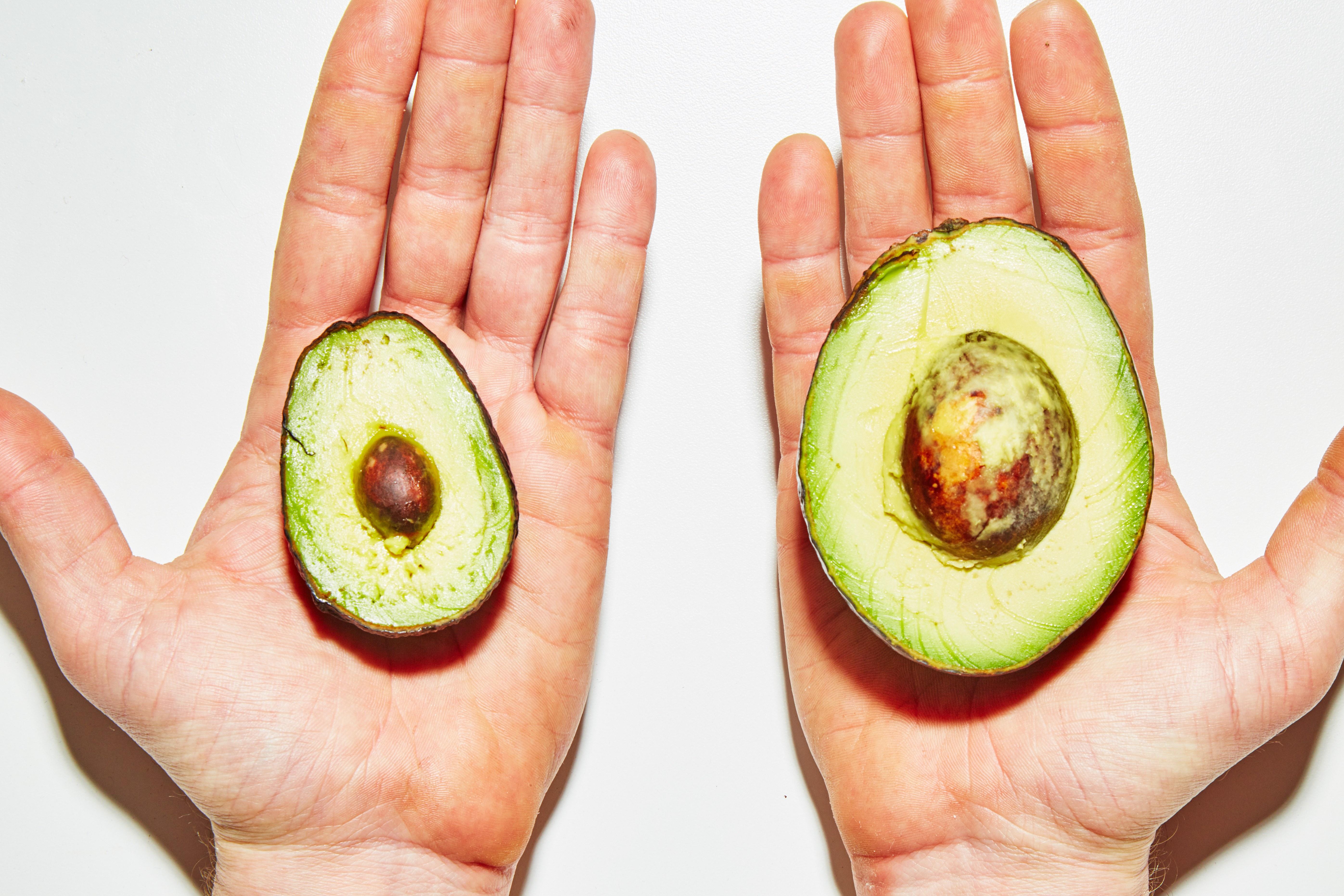 mini avocado next to a normal avocado