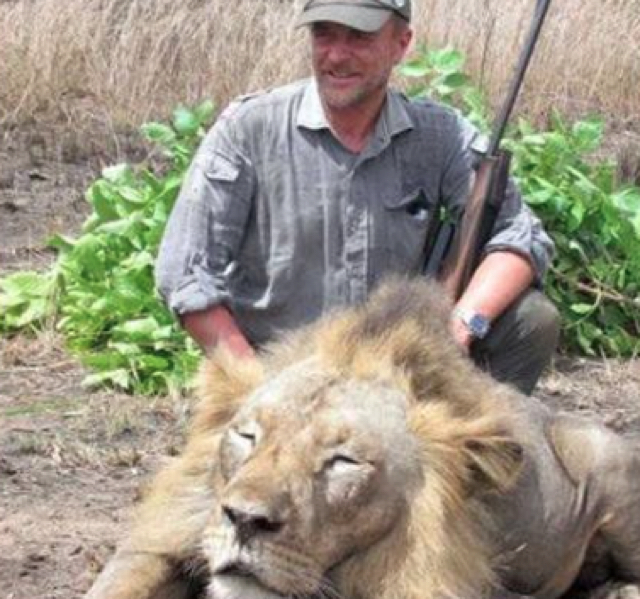 Vet who posed next to lion he killed dies in 100ft fall while hunting