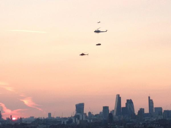 helicopter carrying car over London