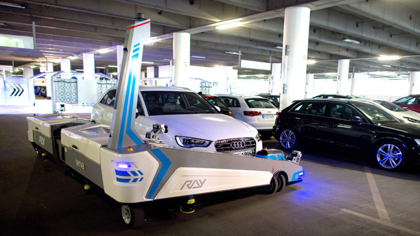 "Parking robot ""Ray"" transports a car in Duesseldorf, Germany, Monday, 23 June 2014. The parking robot will see service for the first time at Duesseldorf Airport. (AP Photo/dpa, Federico Gambarini)"