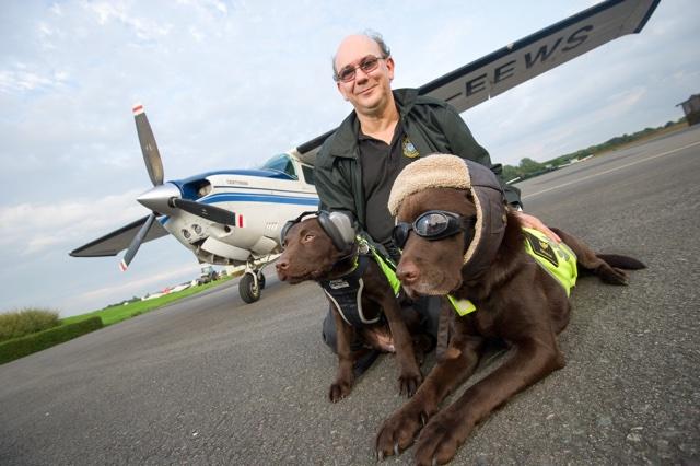 Pooch pilot employs puppy co-pilot