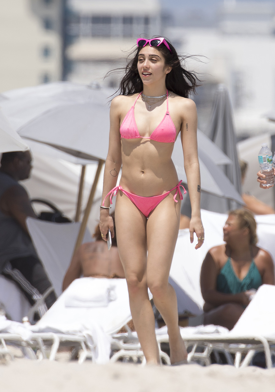 EXCLUSIVE: **PREMIUM EXCLUSIVE RATES APPLY*NO WEB UNTIL 4.30 PM BST 11TH APRIL 2017**Madonna's daughter Lourdes Leon shows off her bikini body on the beach in Miami. Lourdes met up with Madonna's ex-lover Ingrid Casaras for a Sunday afternoon at the beach with friends. The 20-year-old sported a pink bikini with matching pink shades on her head, unshaved armpits and a nose ring. Also several tattoos where on display as she had a play fight with one of her friends. <P> Pictured: Lourdes Leon <B>Ref: SPL1476891  100417   EXCLUSIVE</B><BR/> Picture by: Splash News<BR/> </P><P> <B>Splash News and Pictures</B><BR/> Los Angeles:310-821-2666<BR/> New York:212-619-2666<BR/> London:870-934-2666<BR/> photodesk@splashnews.com<BR/> </P>
