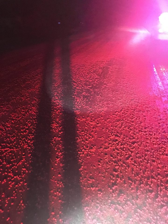 Thousands of Skittles turn road a sea of red