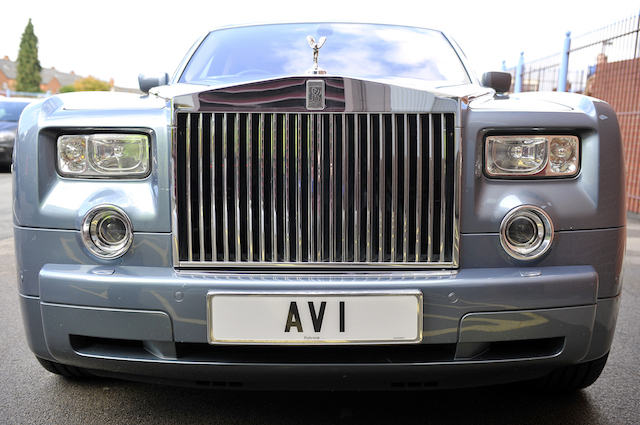 Detail view of a car number plate that read's 'AV 1'