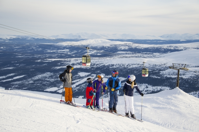 family skiing in are, sweden, scandinavia