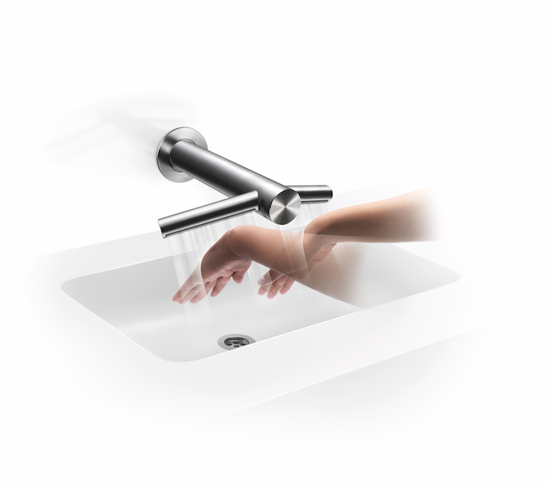 WD06 Wash & Dry WallThree quarter right, wall mounted over sink/basin, hands drying under airblade