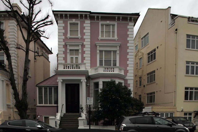 Woman's pink house doesn't go down too well with the neighbours