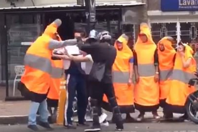 biker and man in traffic cone costume caught fighting in colombia aol