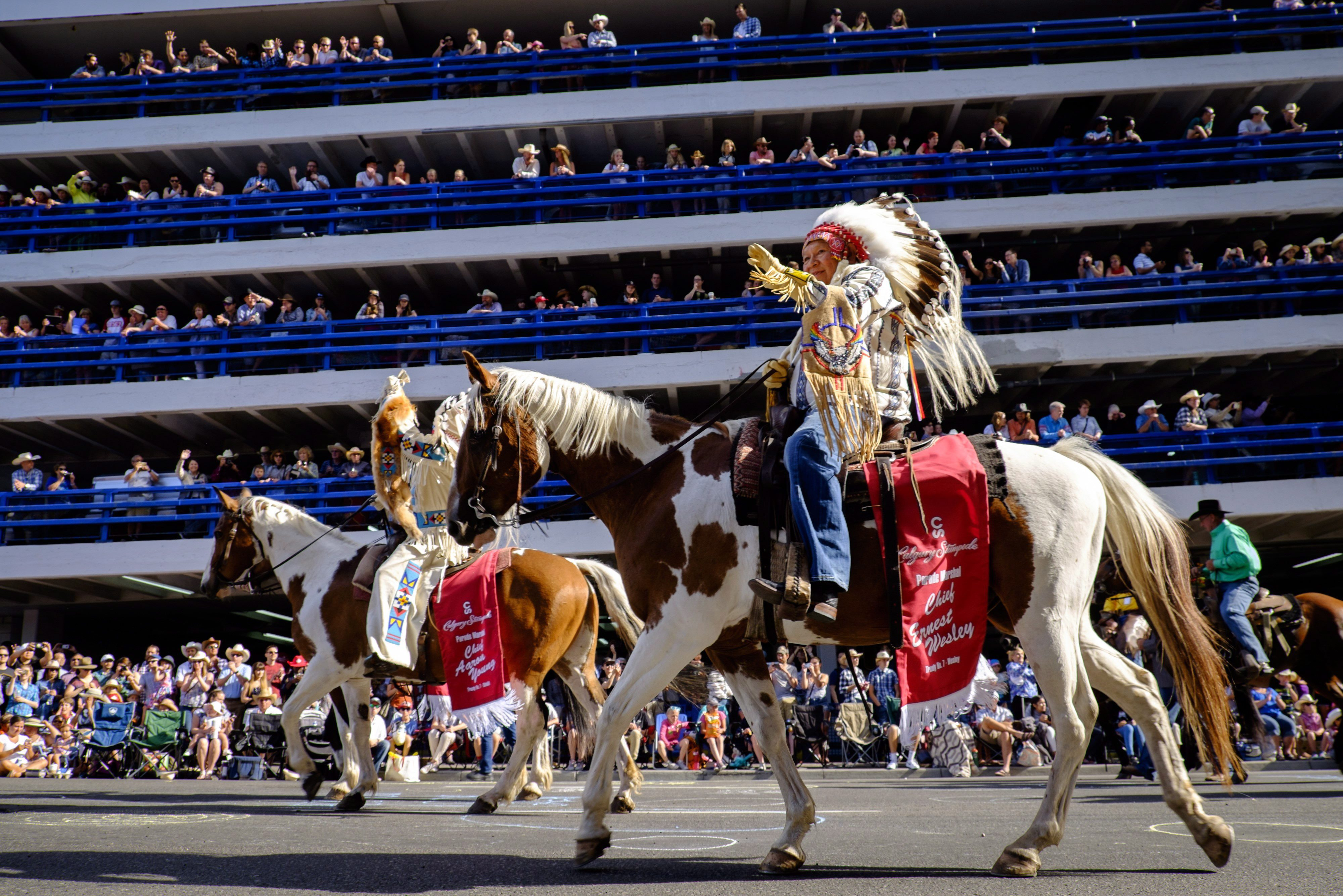 Treaty Seven Chief Ernest Wesley waves as he rides during the Calgary Stampede parade in Calgary, Friday,...