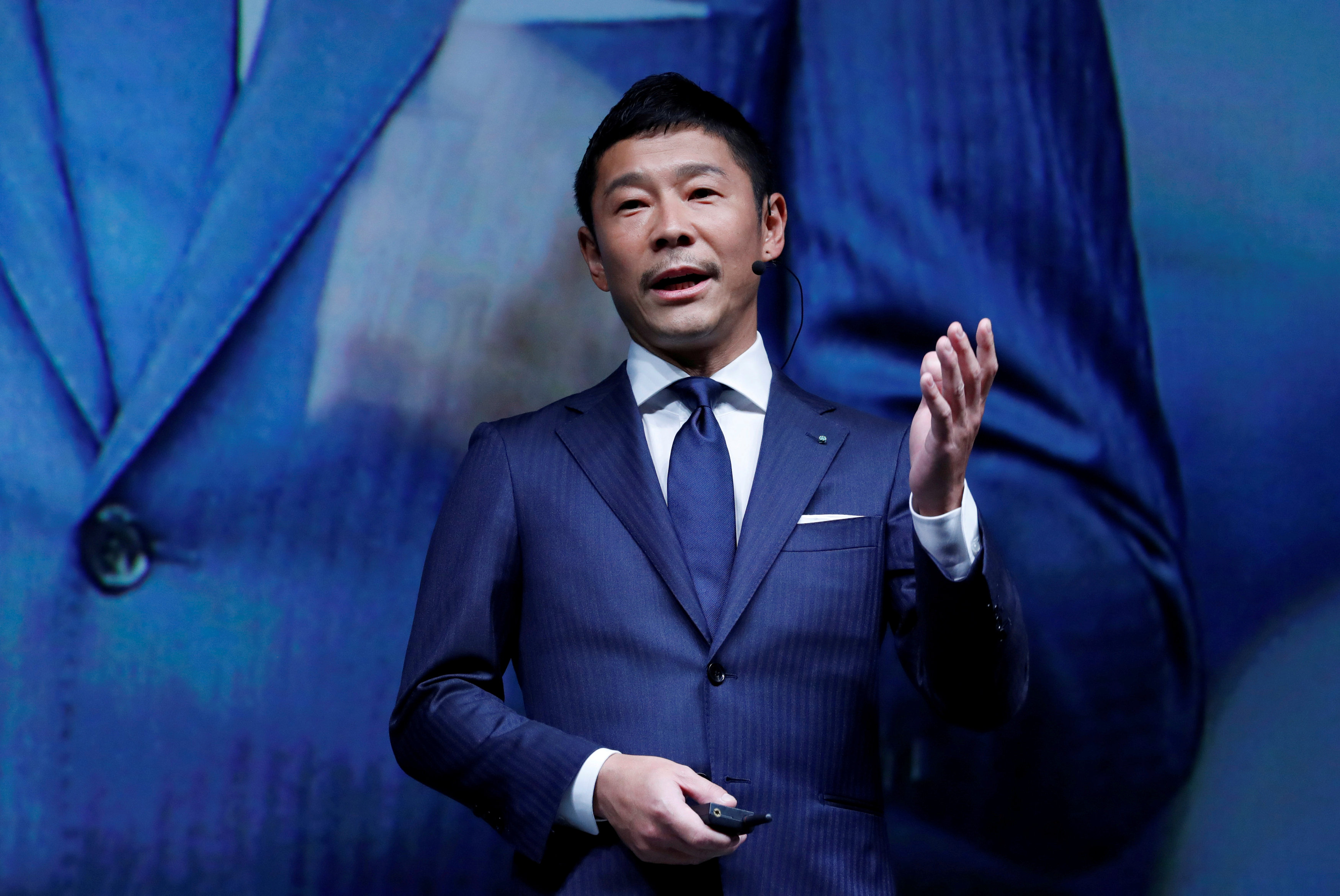 FILE PHOTO: Yusaku Maezawa, the chief executive of Zozo, which operates Japan's popular fashion shopping site Zozotown and is officially called Start Today Co, speaks at an event launching the debut of its formal apparel items, in Tokyo, Japan, July 3, 2018. REUTERS/Kim Kyung-Hoon/File Photo