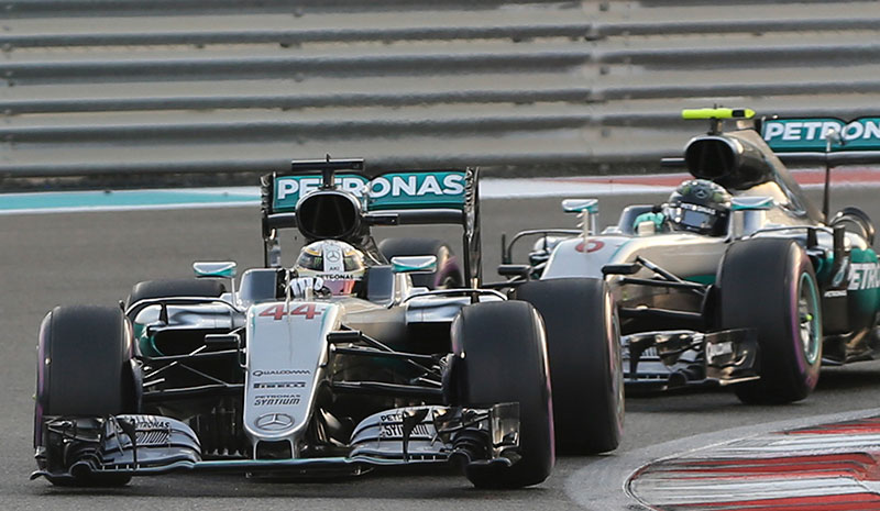 Mercedes driver Lewis Hamilton of Britain, left, steers his car around a corner ahead of team mate Mercedes driver Nico Rosberg of Germany during the Emirates Formula One Grand Prix at the Yas Marina racetrack in Abu Dhabi, United Arab Emirates, Sunday, Nov. 27, 2016.
