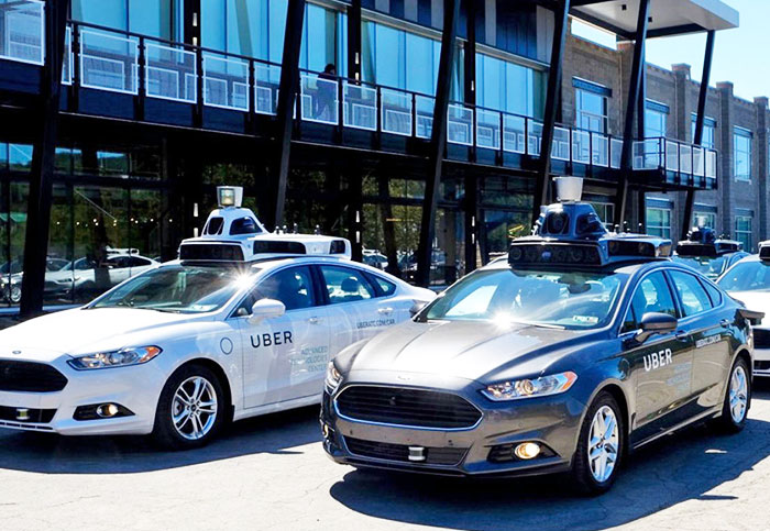 Uber stops all self-driving car tests after fatal accident