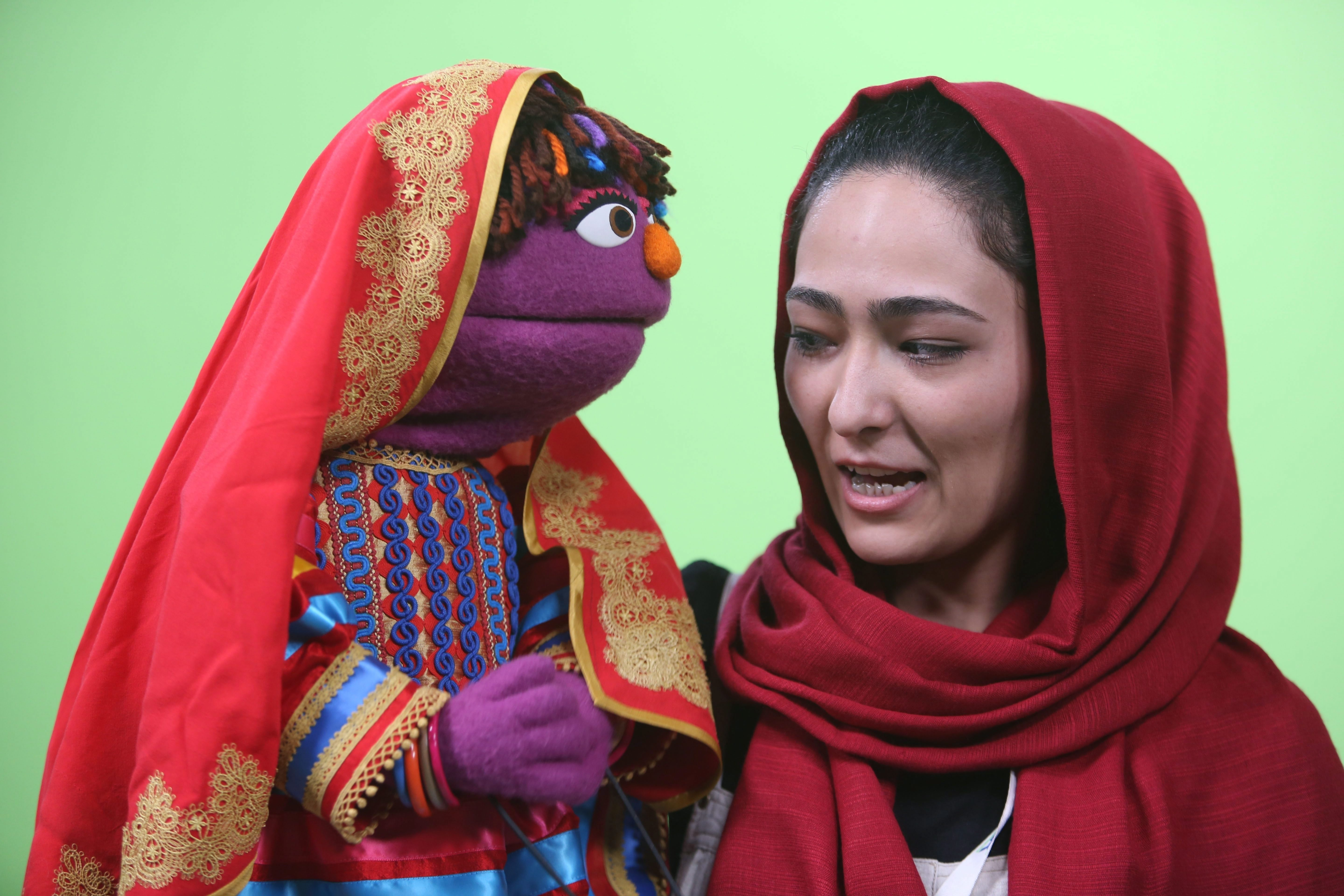 Afghan puppeteer Mansoora Shirzad, right, with Sesame Street's new character, a 6-year-old Afghan girl...