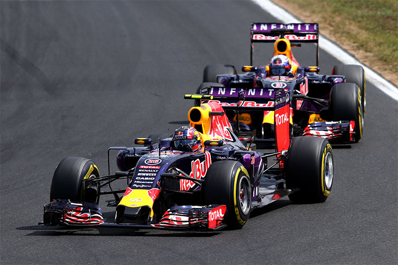 Daniil Kvyat drives ahead of his teammate at the 2015 Hungarian Grand Prix.