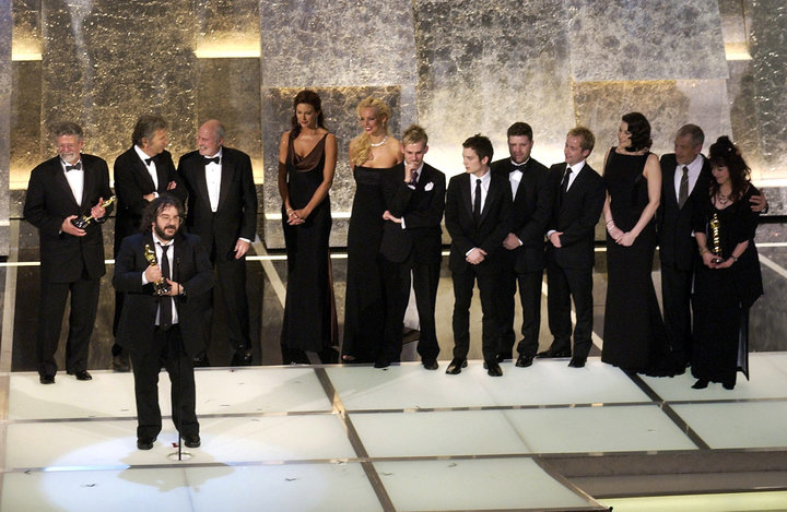 "Peter Jackson with the cast and producers as he accepts his award for Best Picture for ""The Lord..."