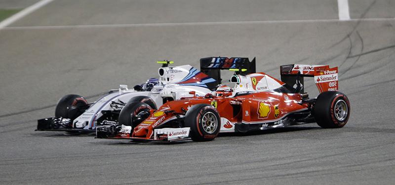Kimi Raikkonen in the Ferrari passes a Williams at the 2016 Bahrain Grand Prix.