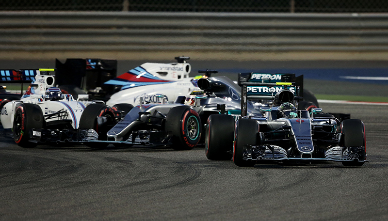 Lewis Hamilton and Valtteri Bottas tangle at the start of the 2016 Bahrain Grand Prix.