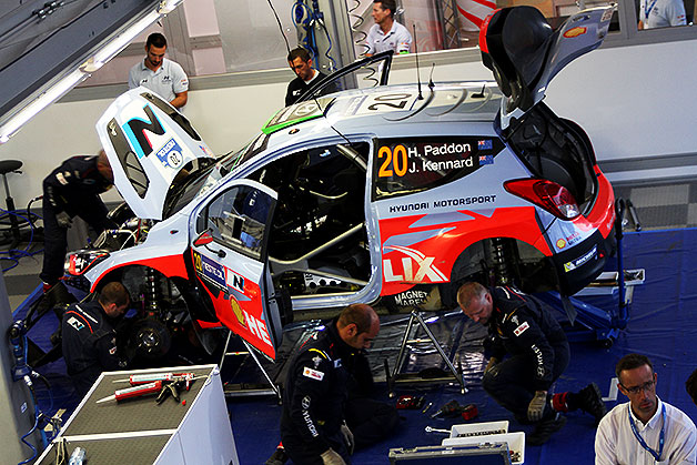 Crews work on a Hyundai i20 WRC in the service park at the Neste Oil Rally Finland.