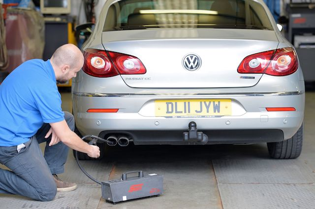 A Volkswagen Passat CC car is tested for its exhaust emissions, at a MOT (Ministry of Transport) testing station in Walthamstow north east London. PRESS ASSOCIATION Photo. Picture date: Thursday 40 September 2015. See PA story  Photo credit should read: John Stillwell/PA Wire