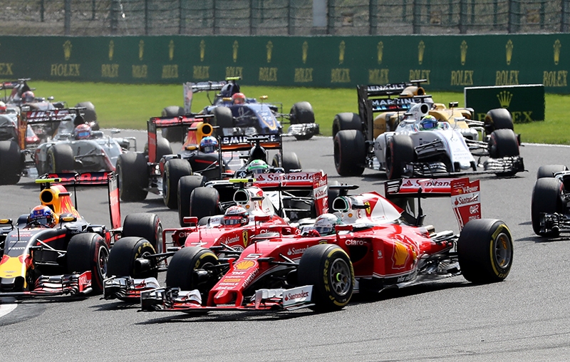 Ferrari's Kimi Raikkonen of Finland (7) crashes with team-mate Sebastien Vettel of Germany (5) at the start of the Belgian F1 Grand Prix