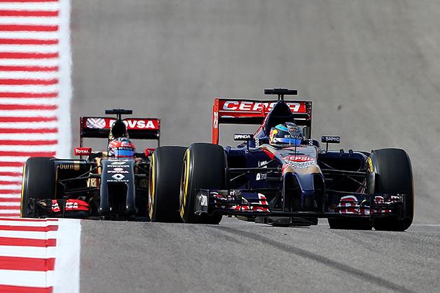 Jean-Eric Verge leads Romain Grosjean at the 2014 US Grand Prix.