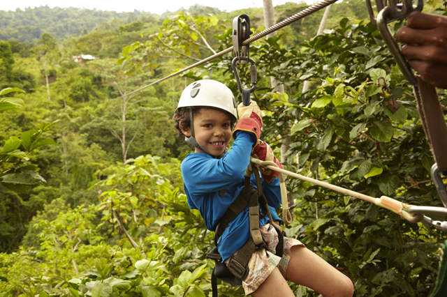 Mandatory Credit: Photo by Blend Images/REX/Shutterstock (4079242a)MODEL RELEASED Mixed Race Boy Zip Lining, Costa Rica, Costa Rica, Costa Rica VARIOUS