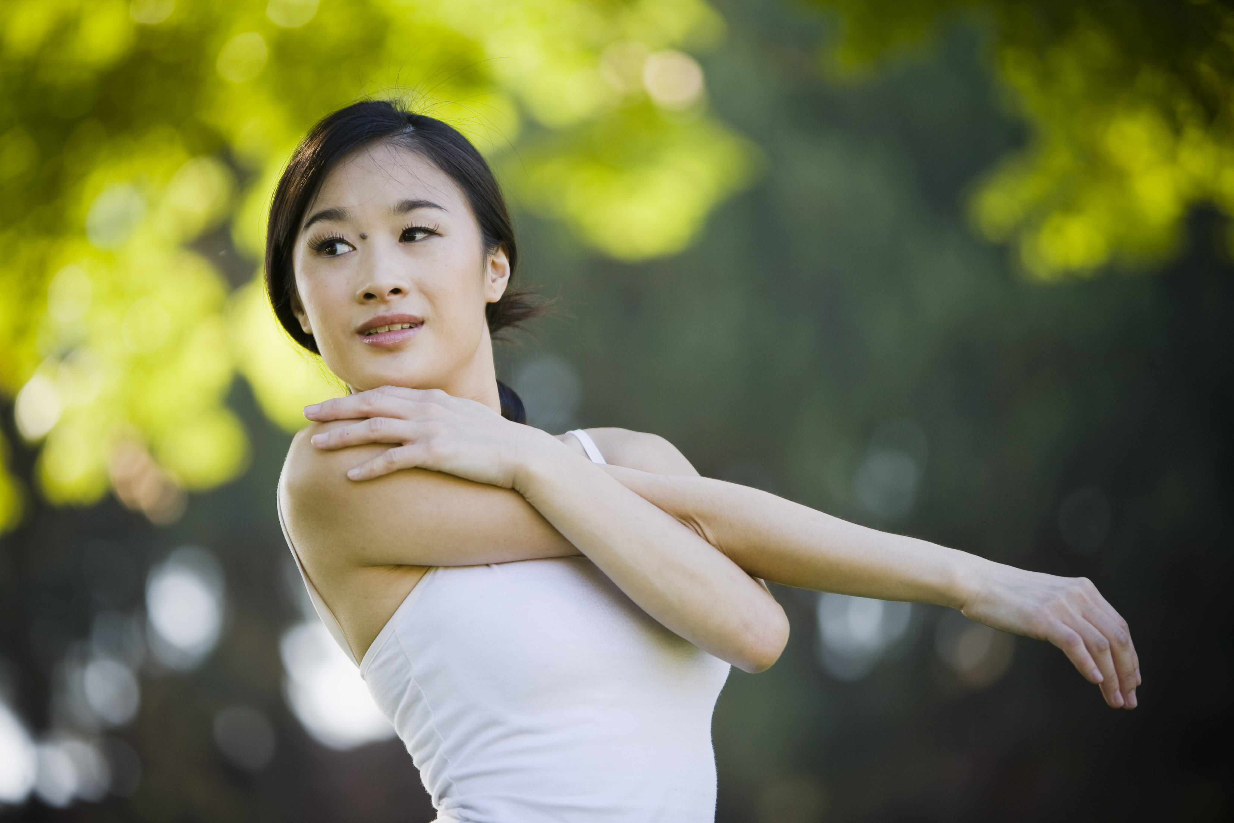 Asian girl stretching for exercise - Horizontal Closeup