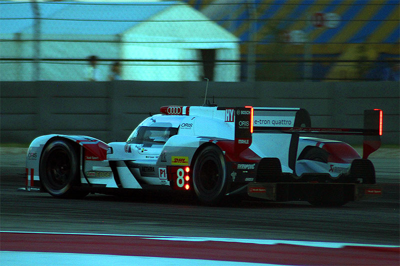 The Audi R18 E-Tron Quattro races at night at the 2015 Lone Star Le Mans.
