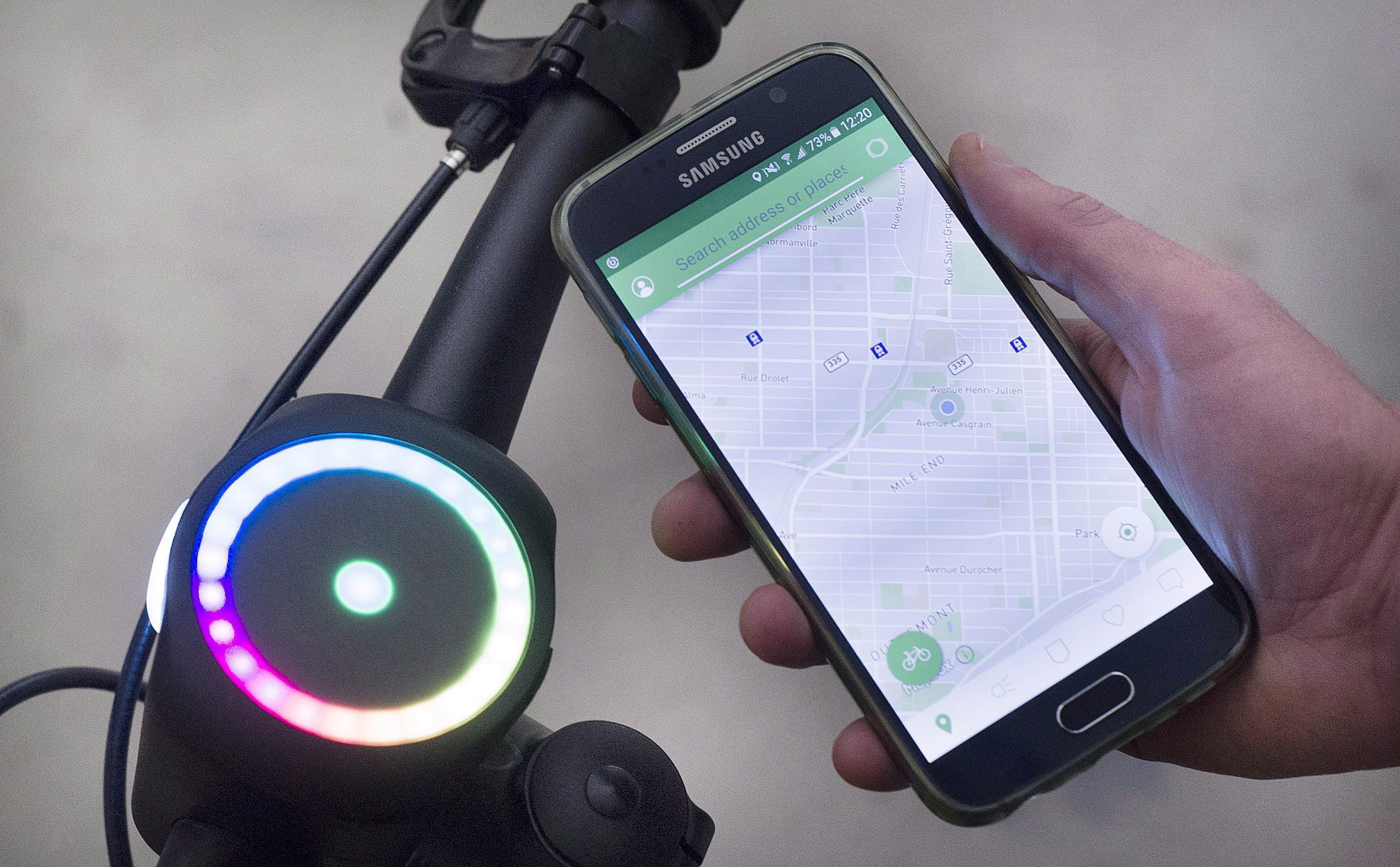 A SmartHalo and accompanying smartphone app is shown on the handlebars of a bicycle at their offices...