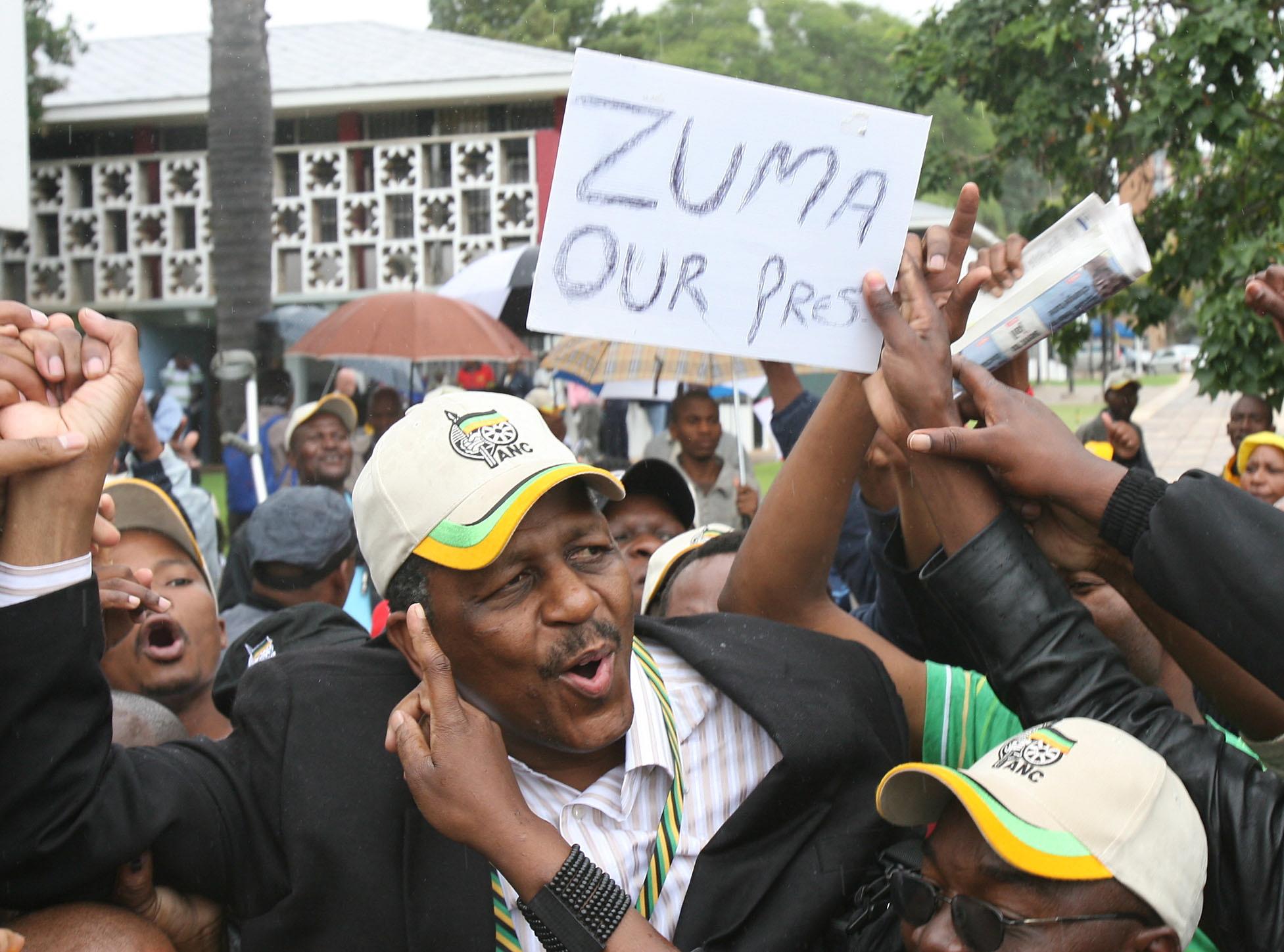 Mathews Phosa, elected alongside Jacob Zuma in 2007, singing and dancing with Zuma supporters at Polokwane....