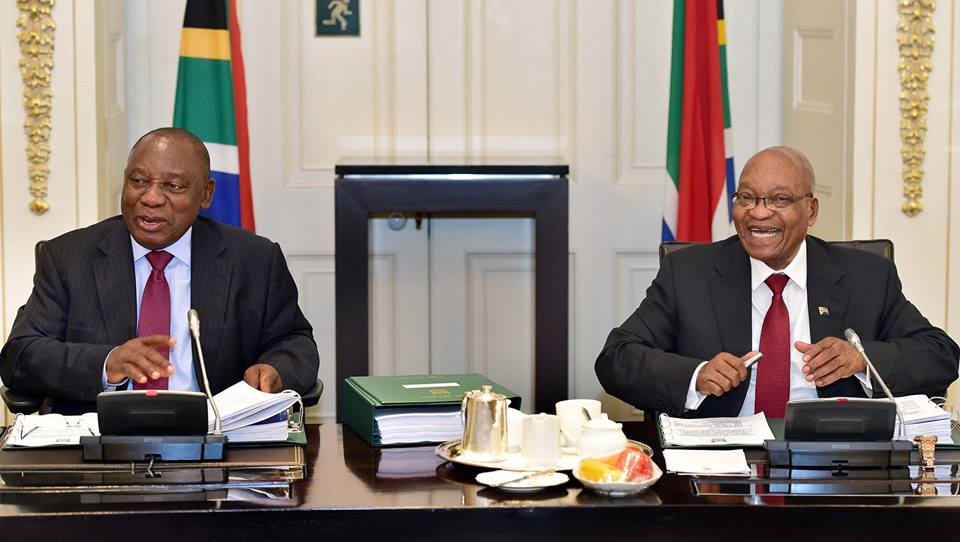 The men of the hour! Zuma, clearly in charge, Cabinet memoranda at the ready, notepad good to go, about...