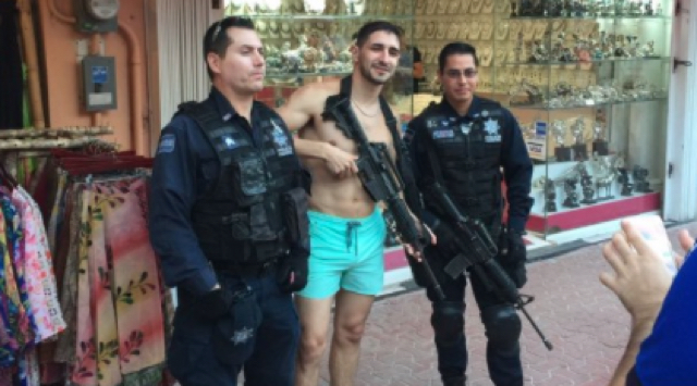Anger after tourist poses for photo with policeman's gun