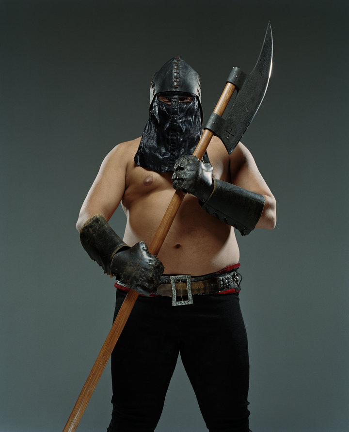 Man wearing leather helmet and mask holding