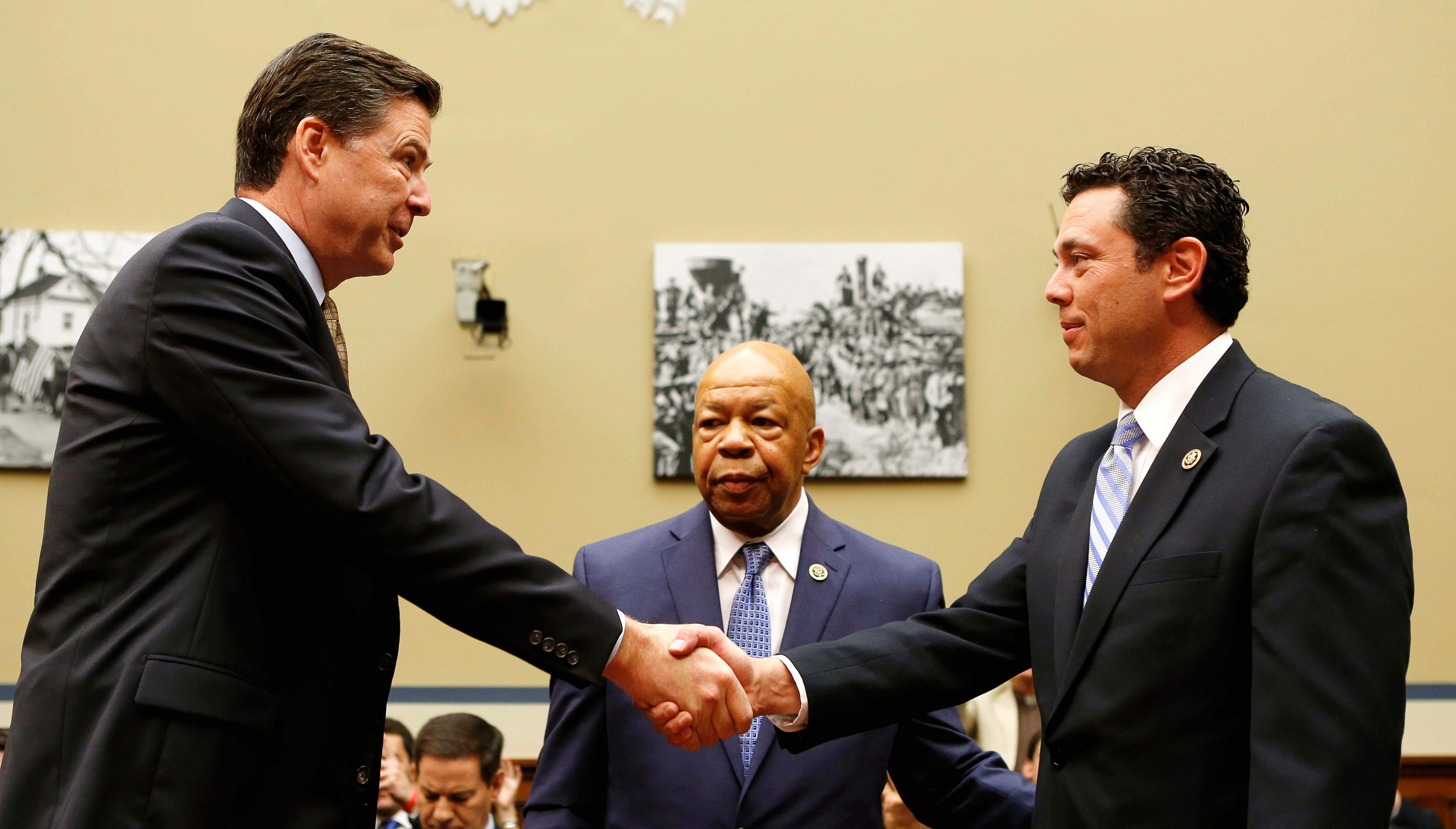 "FBI Director James Comey (L) shakes hands with Chairman Jason Chaffetz (R-CA) (R) and ranking member Elijah Cummings (D-MD) (C) before testifying at a House Oversight and Government Reform Committee on the ""Oversight of the State Department"" in Washington U.S. July 7, 2016.  REUTERS/Gary Cameron"
