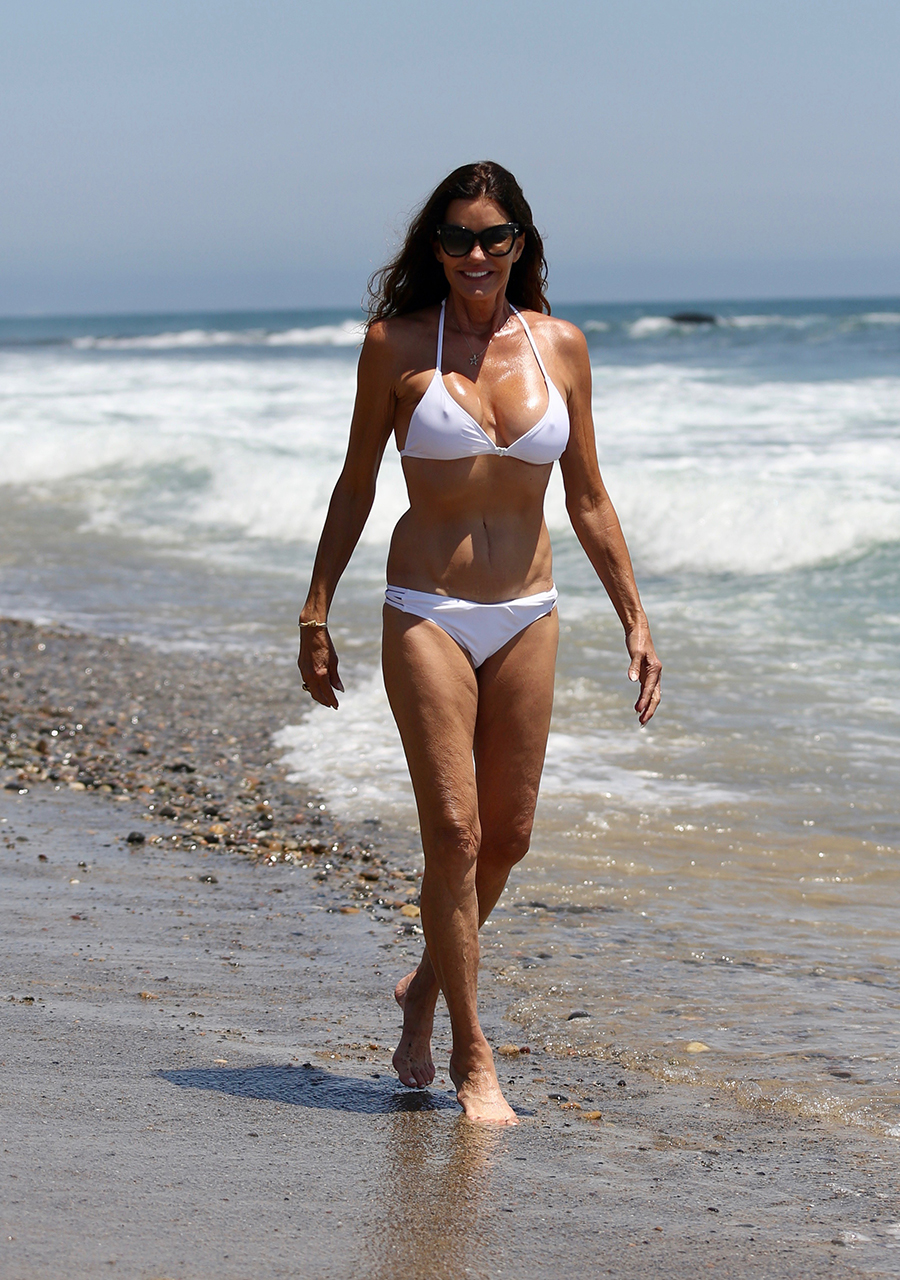 EXCLUSIVE: Janice Dickinson out on the Beach on Independence day in Malibu, Los Angeles.  <P> Pictured: Janice Dickinson <B>Ref: SPL1532799  040717   EXCLUSIVE</B><BR/> Picture by: Danimal / Splash News<BR/> </P><P> <B>Splash News and Pictures</B><BR/> Los Angeles:310-821-2666<BR/> New York:212-619-2666<BR/> London:870-934-2666<BR/> photodesk@splashnews.com<BR/> </P>