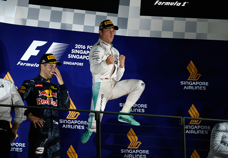 Mercedes' Nico Rosberg of Germany celebrates on the podium after winning the race.