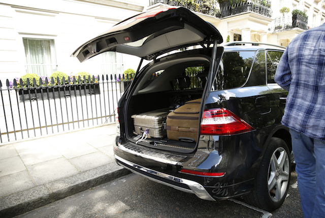 Suitcases are removed from the home of football manager Jose Mourinho in central London.