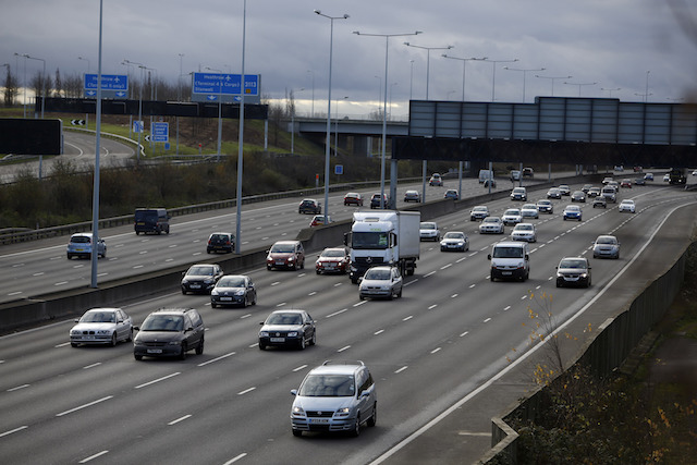 Cars drive on the M25 motorway near Heathrow Airport, as it has been a quiet start to Christmas Eve on the roads and railways, with many workers taking the day off.