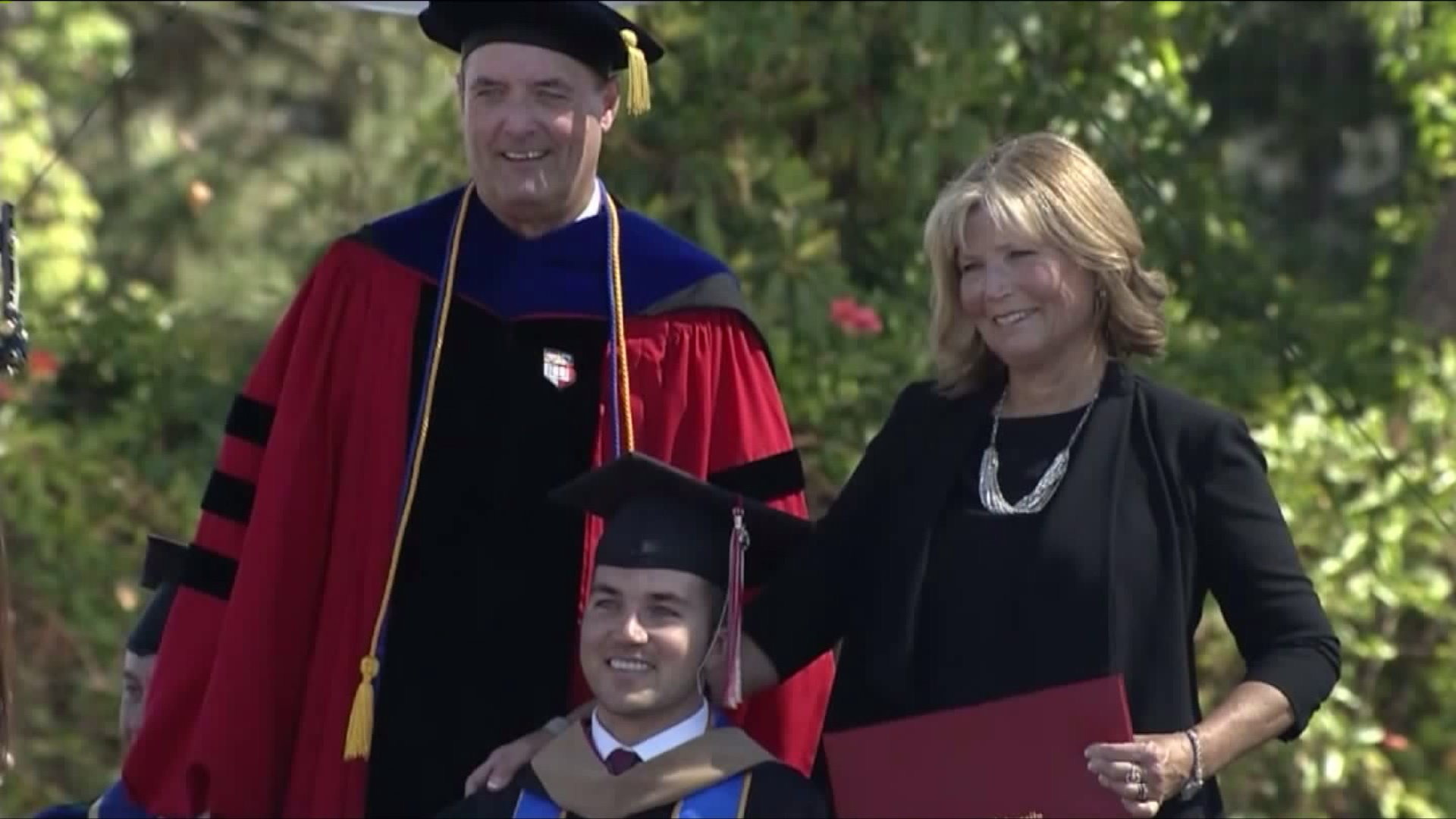 Mom gets degree, too, after helping quadriplegic son