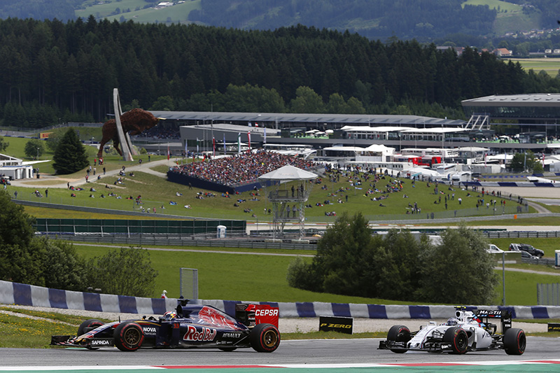 Max Verstappen of Netherlands and Scuderia Toro Rosso drives ahead of Valtteri Bottas of Finland and Williams during the Formula One Grand Prix of Austria.
