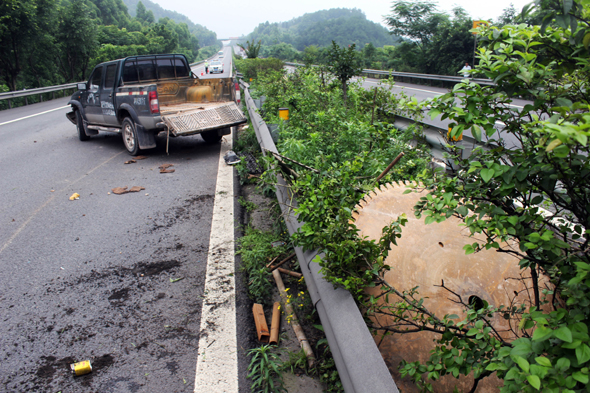 Mandatory Credit: Photo by Imaginechina/REX Shutterstock (4850359g) View of the crashed truck that the circular saw blade came off Circular saw blade slices into car after falling off truck, Chongqing, China - 17 Jun 2015 A man in western China had a close shave after his car was hit by a massive circular saw blade while he was driving along the road. The motorist was driving to Chongqing when he heard a bang come from the opposite lane before spotting a huge circular bouncing through the bushes of the central reservation. The blade then smashed into the front of his vehicle, slicing around 50cm into the bonnet. Highway police said another truck had crashed in the opposite lane and the blade had been thrown off the vehicle and into the road.