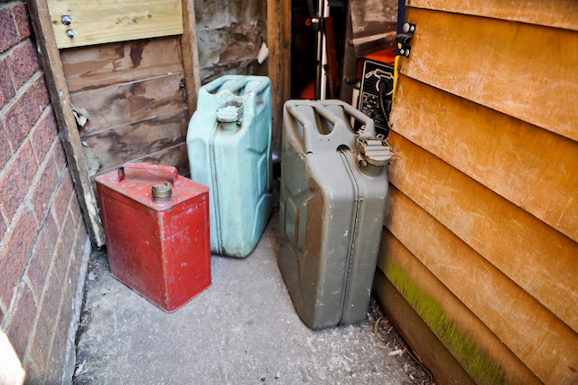 STOCK PHOTO  Metal jerry cans and fuel containers beside a garden shed. PRESS ASSOCIATION Photo. Picture date: Thursday March, 29, 2012. See PA story INDUSTRY Tanker. Photo credit should read: Ben Birchall/PA Wire