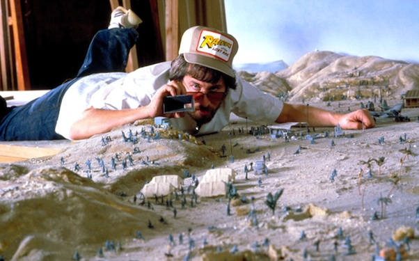 Director Steven Spielberg on a miniature set for RAIDERS OF THE LOST ARK, 1981, (c) Paramount/courtesy Everett Collection
