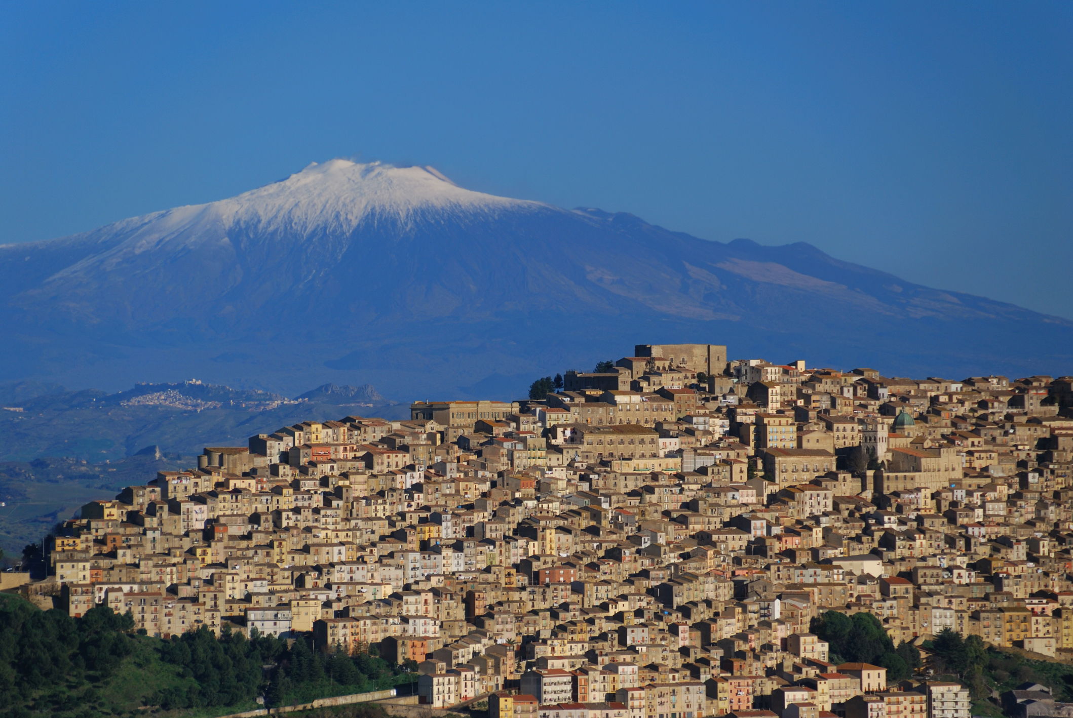 Little village of Gangi and  volcano Etna on background.