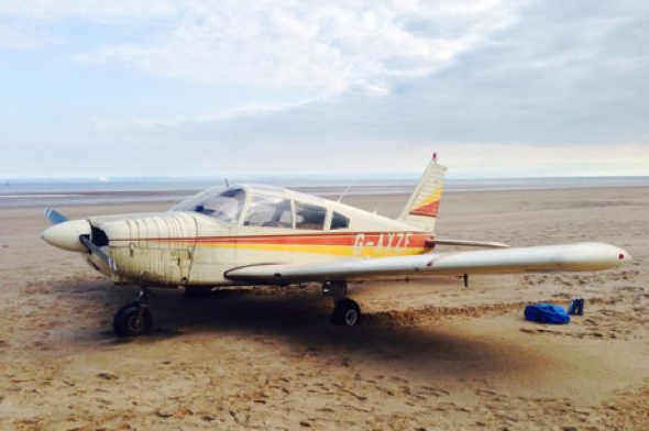 Plane crash-lands on beach in Swansea