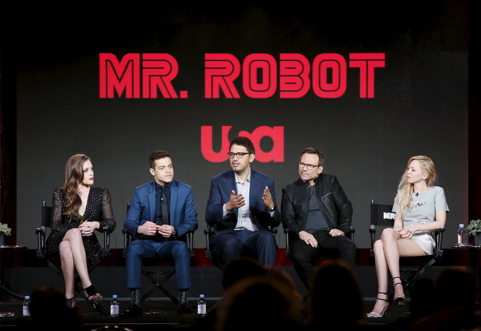 "Creator and executive producer Sam Esmail (C) speaks on stage with cast members Carly Chaikin, Rami Malek, Christian Slater and Portia Doubleday (L-R) during a panel for the USA Network series ""Mr. Robot"" during the Television Critics Association (TCA) Cable Winter Press Tour in Pasadena, California, January 14, 2016. REUTERS/Danny Moloshok"